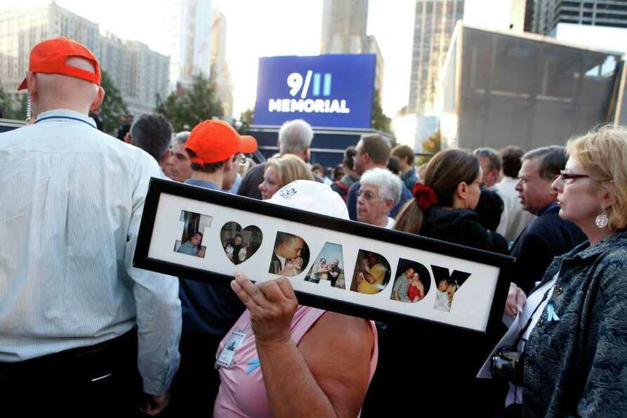 Friends and relatives of the victims of 9/11 gather for a ceremony marking the 10th anniversary of t