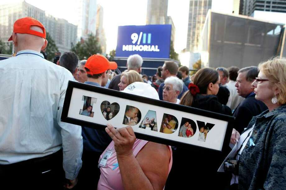 Friends and relatives of the victims of 9/11 gather for a ceremony marking the 10th anniversary of the attacks at the National September 11 Memorial at the World Trade Center site, Sunday, Sept. 11, 2011, in New York. Photo: AP
