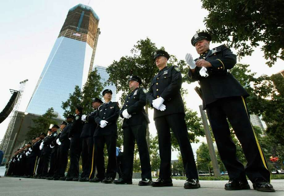New York City police and firefighters, and Port Authority of NY and NJ police line up at one of the entrances of 9/11 Memorial Plaza before the 10th anniversary ceremony at the site of the World Trade Center, Sunday, Sept. 11, 2011, in New York. Photo: AP