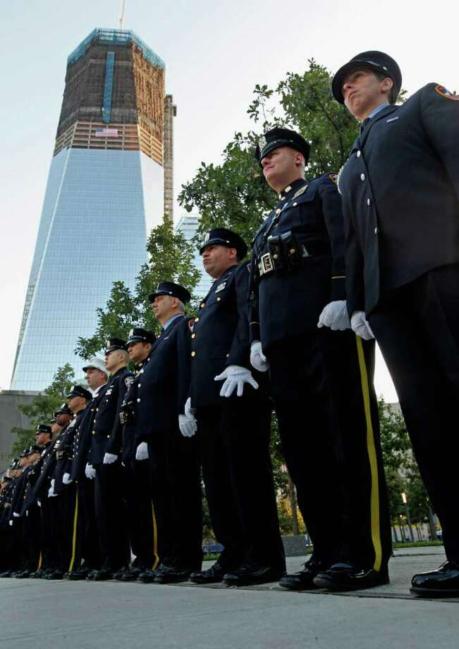 New York police and firefighters and Port Authority police line up at one of the entrances to 9/11 Memorial Plaza at the World Trade Center site before the 10th anniversary ceremony in New York Sunday, Sept. 11, 2011. Photo: AP