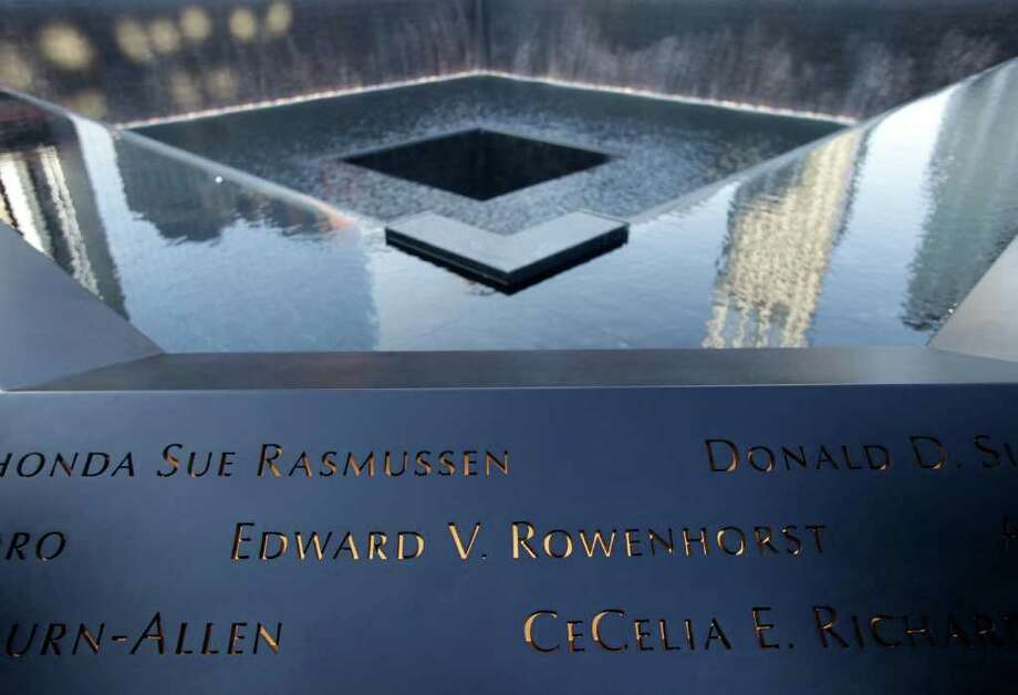 Names of those killed on 9/11 are inscribed around a memorial pool at the National September 11 Memorial at the World Trade Center site in New York before a ceremony marking the 10th anniversary of the attacks on the trade center, Sunday, Sept. 11, 2011. Photo: AP