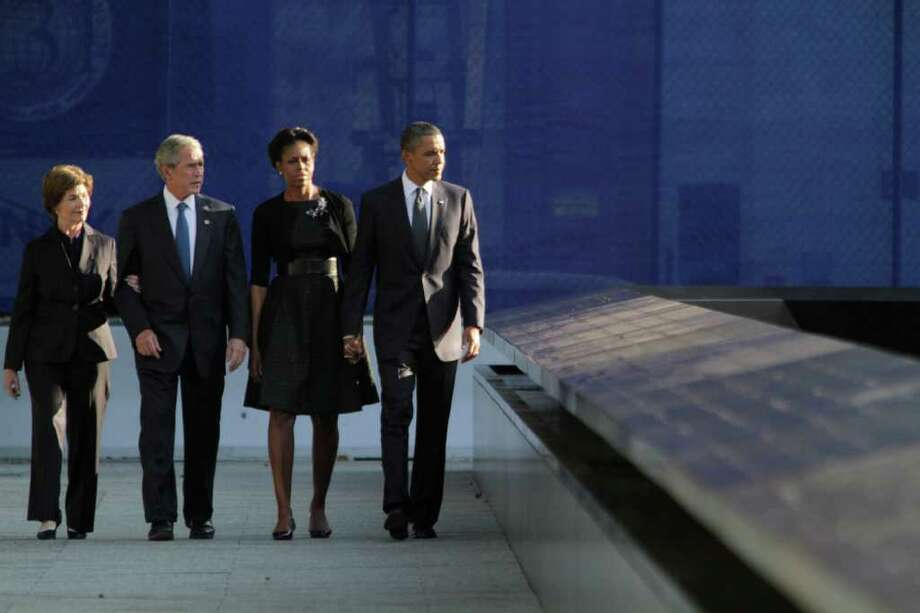 President Barack Obama, right, first lady Michelle Obama, second from right, former President George W. Bush second from left,  and former first lady Laura Bush arrive at the National September 11 Memorial for a ceremony marking the 10th anniversary of the attacks at World Trade Center, Sunday, Sept. 11, 2011 in New York. Photo: AP