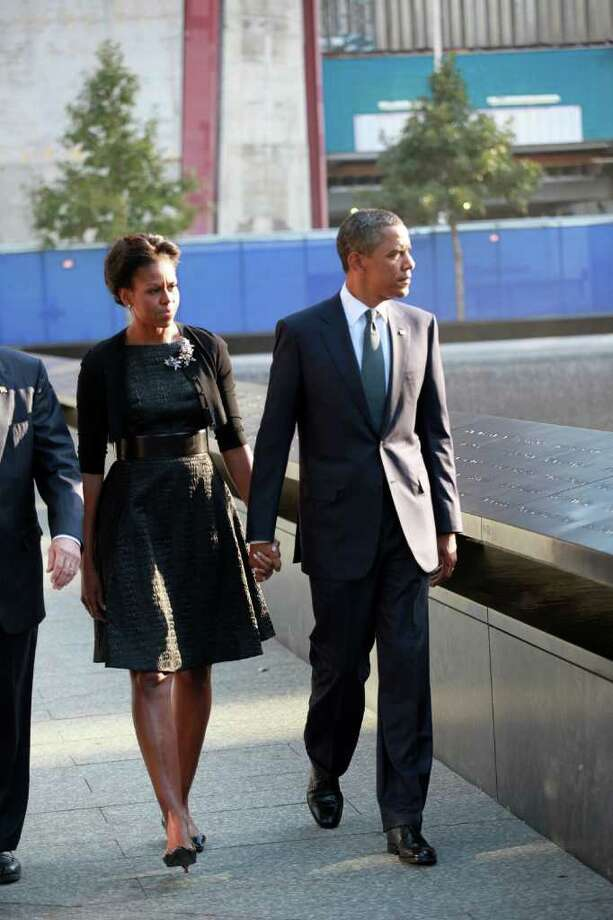 NEW YORK, NY - SEPTEMBER 11:   U.S. President Barack Obama (R), first Lady Michelle Obama  walk past the North Pool of the 9/11 Memorial during the tenth anniversary ceremonies of the September 11, 2001 terrorist attacks at the World Trade Center site, September 11, 2011 in New York City. New York City and the nation are commemorating the tenth anniversary of the terrorist attacks on lower Manhattan which resulted in the deaths of 2,753 people after two hijacked planes crashed into the World Trade Center. Photo: Pool, Getty Images / 2011 Getty Images