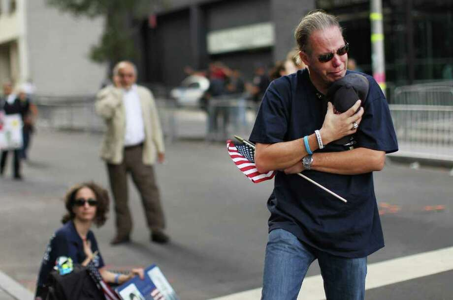 NEW YORK, NY - SEPTEMBER 11: Frank Gotlibowski, who lost a friend at the World Trade Center, observes a moment of silence during ceremonies at the World Trade Center site for the 10th anniversary of the terrorist attacks on lower Manhattan on September 11, 2001 in New York City. New York City and the nation are commemorating the 10th anniversary of the terrorist attacks on lower Manhattan which resulted in the deaths of 2,753 people when two hijacked planes crashed into the World Trade Center.  Security has been heightened in both New York City and Washington D.C. following a terrorist threat about a car bomb. Photo: Spencer Platt, Getty Images / 2011 Getty Images