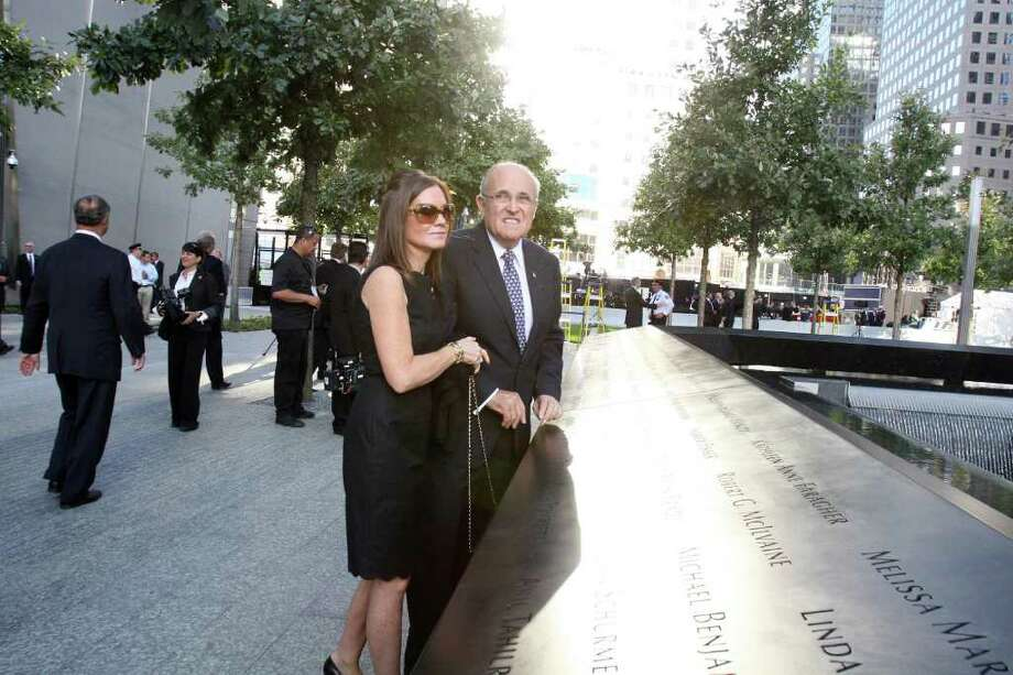 NEW YORK, NY - SEPTEMBER 11:  Former New York City mayor Rudy Giuliani, and his wife, Judith, look out at the North Pool of the 9/11 Memorial during the tenth anniversary ceremonies of the September 11, 2001 terrorist attacks at the World Trade Center site, September 11, 2011 in New York City. New York City and the nation are commemorating the tenth anniversary of the terrorist attacks which resulted in the deaths of nearly 3,000 people after two hijacked planes crashed into the World Trade Center, one into the Pentagon in Arlington, Virginia and one crash landed in Shanksville, Pennsylvania. Photo: Pool, Getty Images / 2011 Getty Images