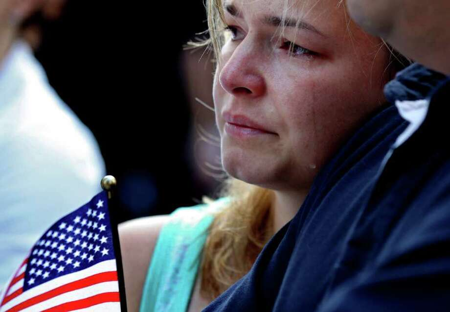 Jacqueline Arana, of Union City, N.J., sheds a tear at 8:46 a.m., marking when the first plane hit the World Trade Center in 2001, during a ceremony in Lower Manhattan, Sunday, Sept. 11, 2011, marking the 10th anniversary of the attacks at the World Trade Center. Photo: AP