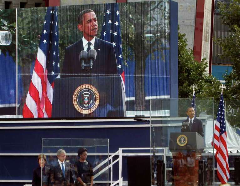 President Barack Obama, far right, speaks as, from left, former First Lady Laura Bush, former Presid