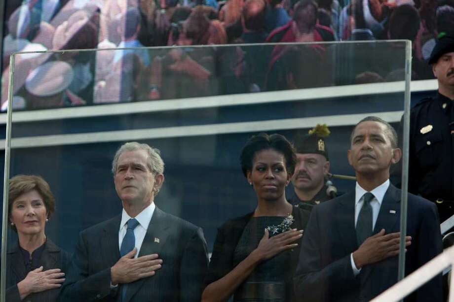 NEW YORK, NY - SEPTEMBER 11: (L-R) Laura Bush, former President George Bush, First Lady Michelle Obama, and President Barack Obama salute at the 9/11 Memorial during the tenth anniversary ceremonies of the September 11, 2001 terrorist attacks at the World Trade Center site, September 11, 2011 in New York City. New York City and the nation are commemorating the tenth anniversary of the terrorist attacks which resulted in the deaths of nearly 3,000 people after two hijacked planes crashed into the World Trade Center, one into the Pentagon in Arlington, Virginia and one crash landed in Shanksville, Pennsylvania. (Photo by Allan Tannenbaum-Pool/Getty Images) Photo: Pool, Getty / 2011 Getty Images