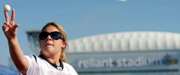 Courtney Hubbard, of League City, plays beer pong with her friends before the Houston Texans' season opening game against the Indianapolis Colts, Sunday, Sept. 11, 2011, in Reliant Stadium in Houston. Photo: Nick De La Torre, Houston Chronicle / © 2011 Houston Chronicle