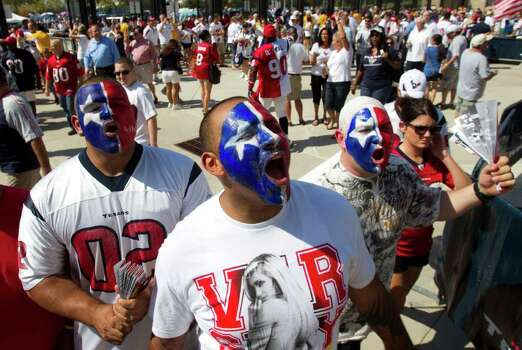 Houston Texans fans, from left, Alonzo Sizable, left, Ryden Cohen and Marcus Way arrive for an NFL football game between the Texans and the Indianapolis Colts at Reliant Stadium Sunday, Sept. 11, 2011, in Houston. Photo: Brett Coomer, Houston Chronicle / © 2011 Houston Chronicle