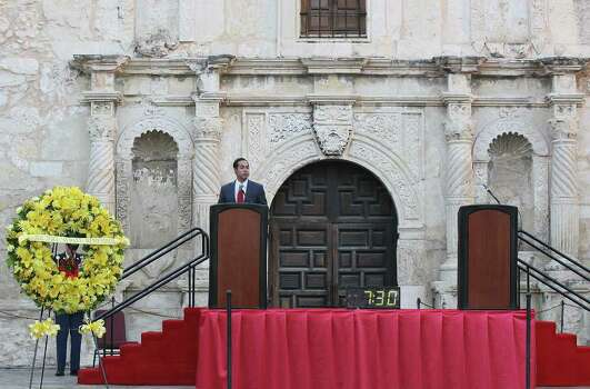 Mayor Julian Castro welcomes the early morning crowd as the City of San Antonio commemorates the 10th anniversary of the September 11 attack on the U.S. with a memorial ceremony on Alamo Plaza, Sunday, Sept. 11, 2011. Photo: JERRY LARA, JERRY LARA/glara@express-news.net / SAN ANTONIO EXPRESS-NEWS