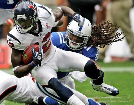 Indianapolis Colts linebacker Philip Wheeler (50) grabs the leg of Houston Texans wide receiver Jacoby Jones (12) in the second quarter of an NFL football game Sunday, Sept. 11, 2011, in Houston. (AP Photo/David J. Phillip) Photo: David J. Phillip, Associated Press / AP