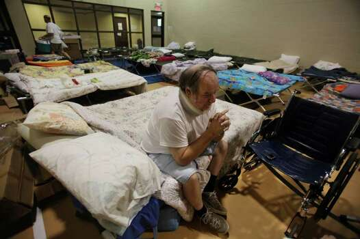 John Buchanan, of Waller County, rest on a cot at the Red Cross Shelter located inside Wildwood United Methodist Church on Sunday, Sept. 11, 2011, in Magnolia. The Red Cross is still taking donations at the shelter where they housed 100 clients last night. Photo: Mayra Beltran, Houston Chronicle / © 2011 Houston Chronicle
