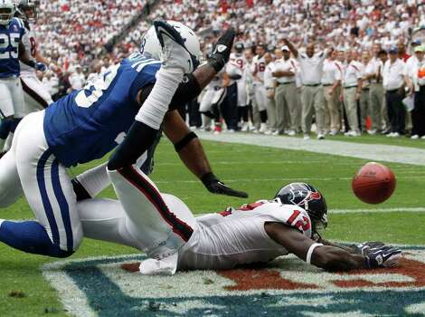 Indianapolis Colts linebacker Gary Brackett (58) looms over Houston Texans' Jacoby Jones (12) in the first quarter of an NFL football game Sunday, Sept. 11, 2011, in Houston. (AP Photo/Eric Gay) Photo: Eric Gay, Associated Press / AP