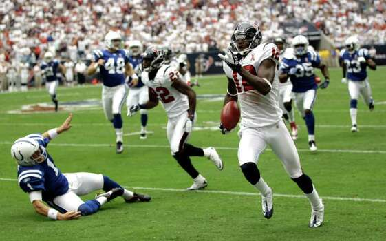 Houston Texans' Jacoby Jones (12) returns a punt 79 yards for a touchdown as defensive back Sherrick McManis (22) knocks Indianapolis Colts punter Pat McAfee (1) to the turf in the second quarter of an NFL football game Sunday, Sept. 11, 2011, in Houston. (AP Photo/David J. Phillip) Photo: David J. Phillip, Associated Press / AP