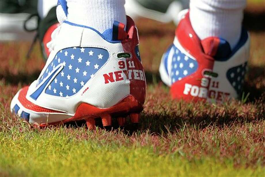 New York Giants defensive back Kenny Phillips wears shoes commemorating 9/11 before an NFL football game against the Washington Redskins in Landover, Md., on Sunday, Sept. 11, 2011.  (AP Photo/Susan Walsh) Photo: Associated Press