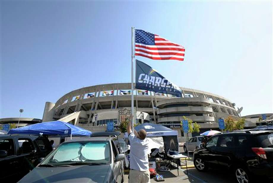 A San Diego Chargers fan raises flags in a parking lot before the Chargers' NFL football game against the Minnesota Vikings on Sunday, Sept. 11, 2011, in San Diego. (AP Photo/Denis Poroy) Photo: Associated Press