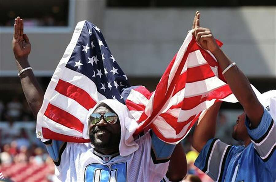 Detroit Lions fans celebrate a second quarter touchdown reception by  Calvin Johnson during an NFL f