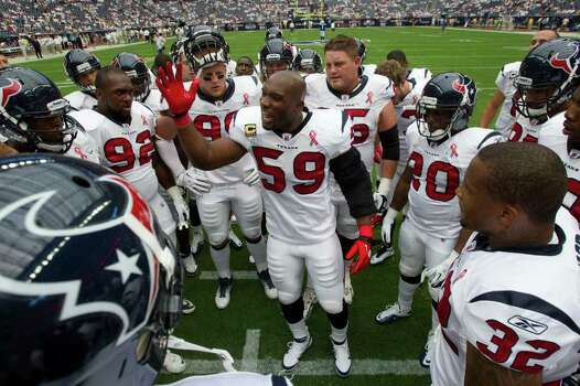 Houston Texans linebacker DeMeco Ryans (59) huddles the team before facing the Indianapolis Colts in an NFL football game at Reliant Stadium Sunday, Sept. 11, 2011, in Houston. Photo: Brett Coomer, Houston Chronicle / © 2011 Houston Chronicle