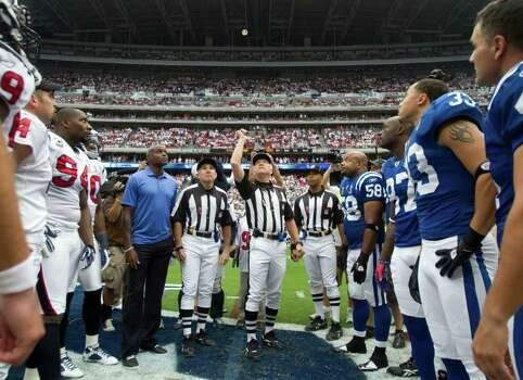 The Houston Texans and Indianapolis Colts watch the pregame coin toss before an NFL football game at Reliant Stadium Sunday, Sept. 11, 2011, in Houston. Photo: Brett Coomer, Houston Chronicle / © 2011 Houston Chronicle