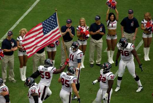 Houston Texans linebacker Brian Cushing (56) runs on to the field carrying the American flag before an NFL football game against the Indianapolis Colts at Reliant Stadium on Sunday, Sept. 11, 2011, in Houston. Photo: Smiley N. Pool, Houston Chronicle / © 2011  Houston Chronicle