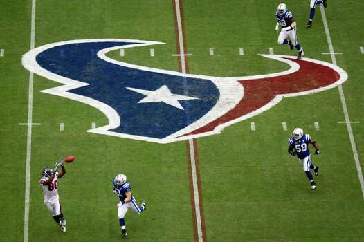 Houston Texans linebacker Mario Williams (90) makes a catch past Indianapolis Colts linebacker Pat Angerer (51) on the first play from scrimmage during the first half of an NFL football game at Reliant Stadium on Sunday, Sept. 11, 2011, in Houston. Photo: Smiley N. Pool, Houston Chronicle / © 2011  Houston Chronicle