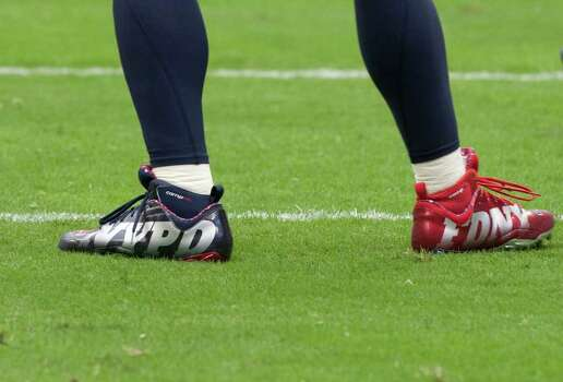 Houston Texans linebacker Brian Cushing (56) wears shoe bearing NYPD and NYFD in honor of New York police and firefighter during the first quarter of an NFL football game against the Indianapolis Colts at Reliant Stadium Sunday, Sept. 11, 2011, in Houston. Photo: Brett Coomer, Houston Chronicle / © 2011 Houston Chronicle