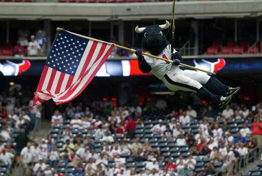Houston Texans mascot Toro flies into the stadium carrying an American flag before of an NFL football game against the Indianapolis Colts at Reliant Stadium Sunday, Sept. 11, 2011, in Houston. Photo: Brett Coomer, Houston Chronicle / © 2011 Houston Chronicle