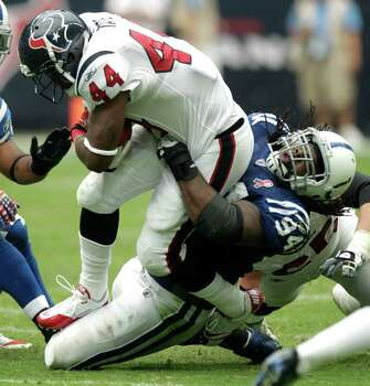 Houston Texans running back Ben Tate (44) is tackled by Indianapolis Colts defensive tackle Drake Nevis (94) during the third quarter of an NFL football game at Reliant Stadium Sunday, Sept. 11, 2011, in Houston. The Texans beat the Colts 34-7. Photo: Brett Coomer, Houston Chronicle / © 2011 Houston Chronicle