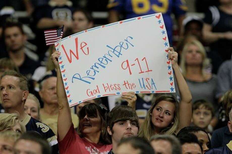 Fans hold up a sign in honor of the 10th anniversary of the Sept. 11 terrorist attacks, during the first quarter of an NFL football game between the St. Louis Rams and the Philadelphia Eagles Sunday, Sept. 11, 2011 in St. Louis. (AP Photo/Seth Perlman) Photo: Associated Press
