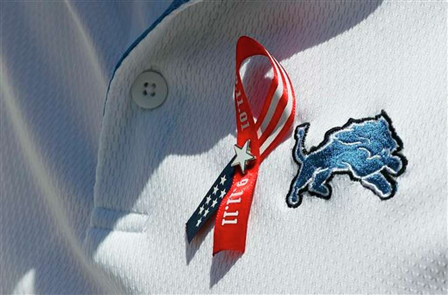 Detroit Lions head coach Jim Schwartz wears a Sept. 11th ribbon on his shirt in honor of the victims of the attacks back in 2001 before an NFL football game against the Tampa Bay Buccaneers Sunday, Sept. 11, 2011, in Tampa, Fla. (AP Photo/Chris O'Meara) Photo: Associated Press