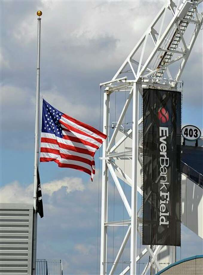 The American Flag flies at half mast during the first half of an NFL football game between the Jacksonville Jaguars and the Tennessee Titans, Sunday, Sept. 11, 2011, in Jacksonville, Fla. (AP Photo/Stephen Morton) Photo: Associated Press