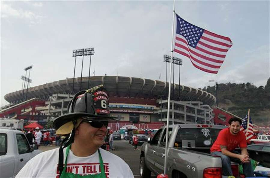 Firefighter Greg Garcia from Clemets, Calif., tailgates before an NFL football game between the San