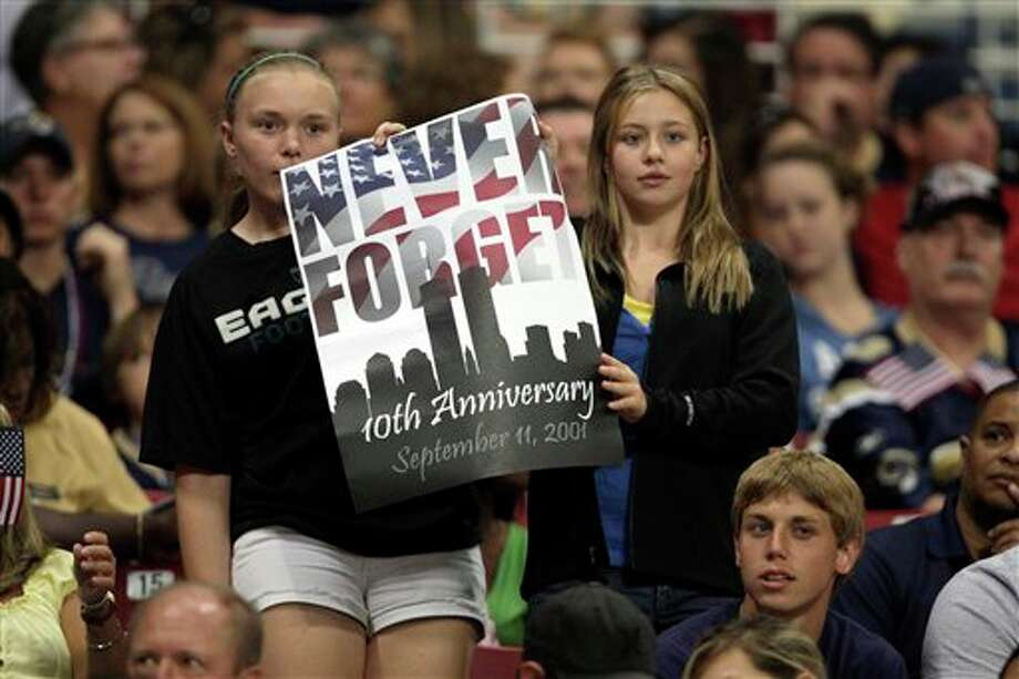 Football fans hold up a sign in honor of the 10th anniversary of the Sept. 11 terrorist attacks during the first quarter of an NFL football game between the St. Louis Rams and the Philadelphia Eagles Sunday, Sept. 11, 2011 in St. Louis. (AP Photo/Tom Gannam) Photo: Associated Press