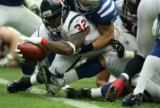 Houston Texans running back Derrick Ward (32) pushed into the end zone for the touchdown against the Indianapolis Colts during the first quarter of a NFL game, Sunday, Sept. 11, 2011, at Reliant Stadium in Houston. Photo: Nick De La Torre, Houston Chronicle / © 2011 Houston Chronicle