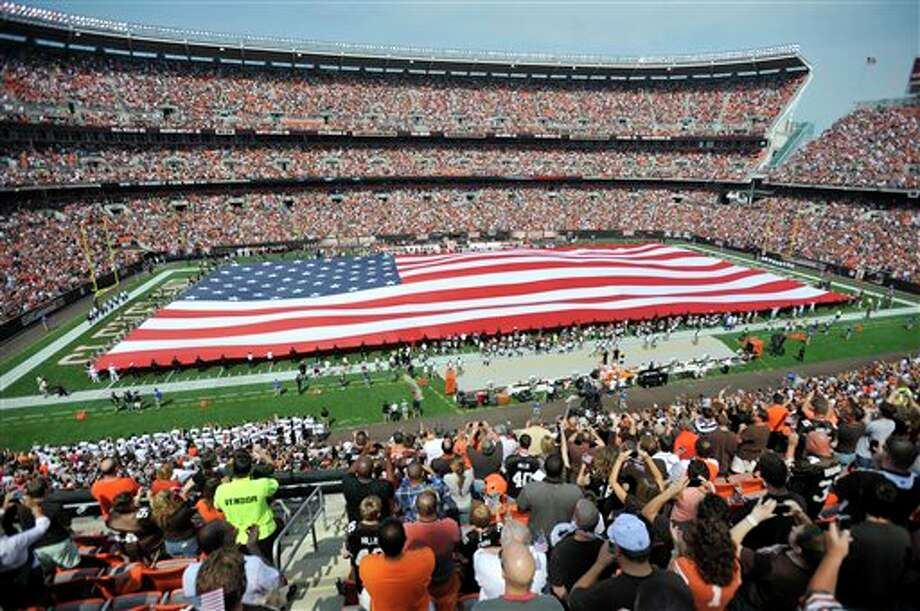 A giant flag is unveiled before the Cleveland Browns play the Cincinnati Bengals in an NFL football game, Sunday, Sept. 11, 2011, in Cleveland. (AP Photo/David Richard) Photo: Associated Press