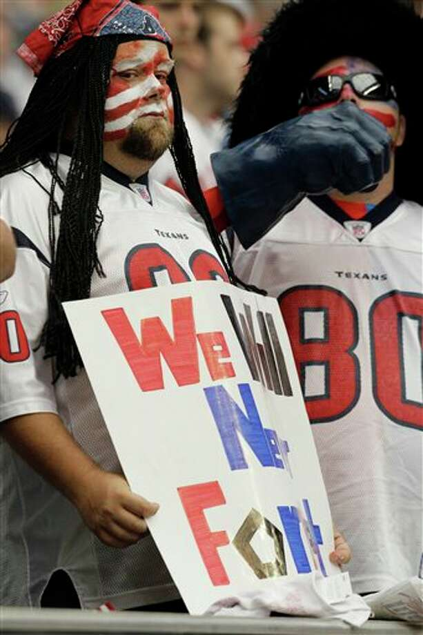 Houston Texans fans show their patriotism before an NFL football game against the Indianapolis Colts, Sunday, Sept. 11, 2011, in Houston. (AP Photo/Eric Gay) Photo: Associated Press