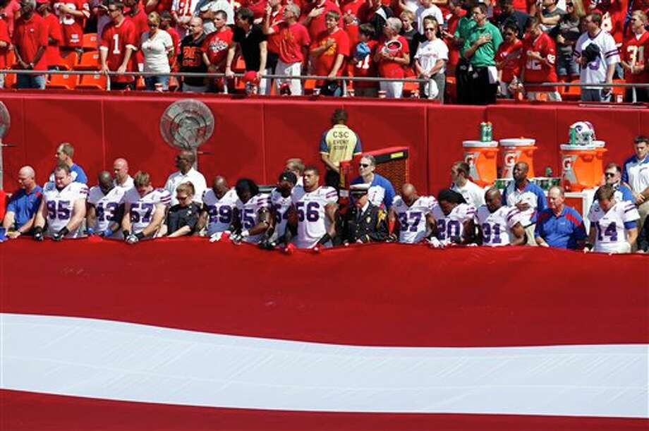Buffalo Bills players and first responders hold an American flag before an NFL football game against the Kansas City Chiefs at Arrowhead Stadium in Kansas City, Mo., Sunday, Sept. 11, 2011. (AP Photo/Orlin Wagner) Photo: Associated Press