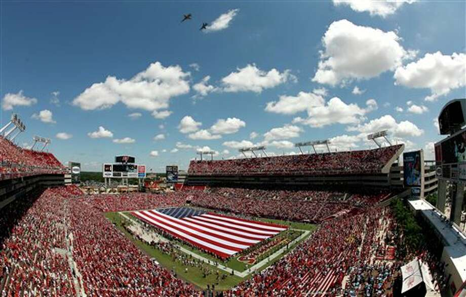 A military flyover takes place at the conclusion of the national anthem before an NFL football game between the Tampa Bay Buccaneers and the Detroit Lions, Sunday, Sept. 11, 2011, in Tampa, Fla. Sunday marked the 10th anniversary of the 9/11 terrorist attacks. (AP Photo/Reinhold Matay) Photo: Associated Press