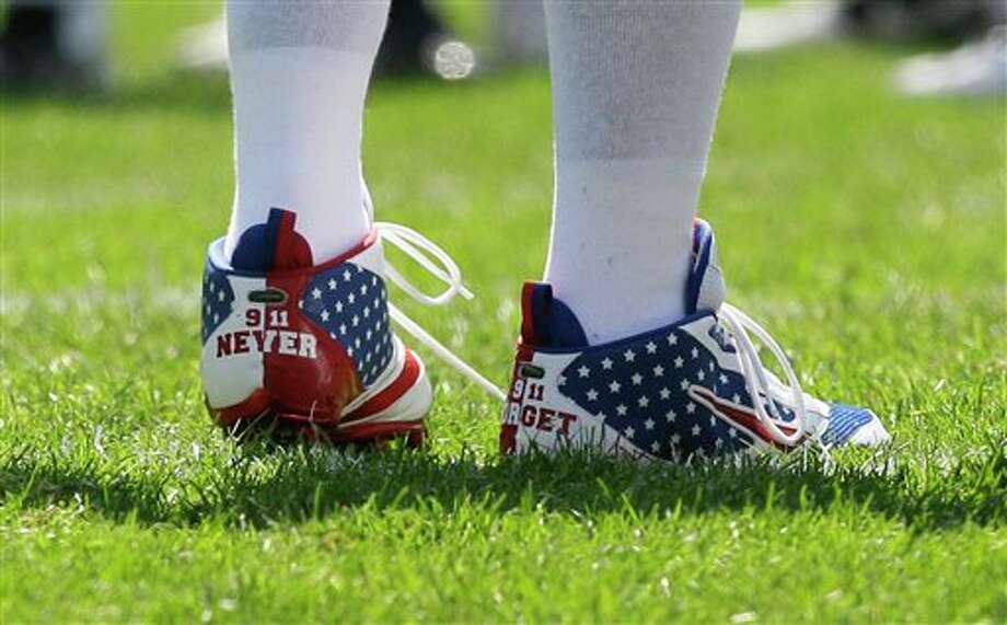 Chicago Bears linebacker Lance Briggs wears commemorative shoes on the 10th anniversary of the 9/11 terrorist attacks before an NFL football game against the Atlanta Falcons in Chicago, Sunday, Sept. 11, 2011. (AP Photo/Nam Y. Huh) Photo: Associated Press