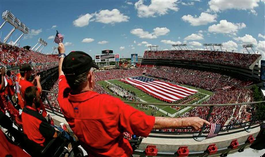 Tampa Bay Buccaneers fans honor America during playing of the national Anthem before an NFL football game against the Detroit Lions Sunday, Sept. 11, 2011, in Tampa, Fla. (AP Photo/Reinhold Matay) Photo: Associated Press