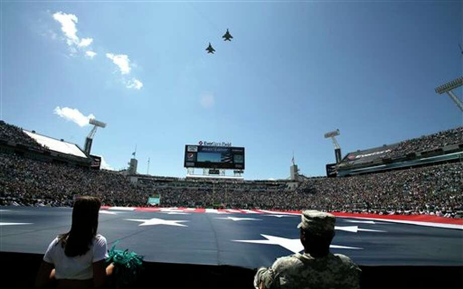 Military jets fly over EverBank field during the National Anthem during 9-11 ceremony prior to an NFL football game between the Jacksonville Jaguars and the Tennessee Titans Sunday, Sept. 11, 2011, in Jacksonville, Fla.(AP Photo/John Raoux) Photo: Associated Press