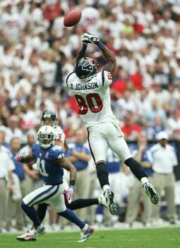 Houston Texans receiver Andre Johnson has a pass tip off his fingers, only to be intercepted, against the Indianapolis Colt during the first quarter of a NFL game, Sunday, Sept. 11, 2011, in Reliant Stadium in Houston. Photo: Nick De La Torre, Houston Chronicle / © 2011 Houston Chronicle