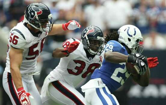 Houston Texans defenders Brian Cushing (56) and Danieal Manning (38) chase Indianapolis Colts running back Joseph Addai (29) during the first quarter of a NFL game, Sunday, Sept. 11, 2011, at Reliant Stadium in Houston. Photo: Nick De La Torre, Houston Chronicle / © 2011 Houston Chronicle