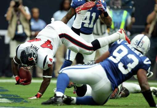 Houston Texans running back Ben Tate (44) gets into the end zone for a touchdown past Indianapolis Colts defensive end Dwight Freeney (93) during the first quarter of a NFL game, Sunday, Sept. 11, 2011, at Reliant Stadium in Houston. Photo: Nick De La Torre, Houston Chronicle / © 2011 Houston Chronicle