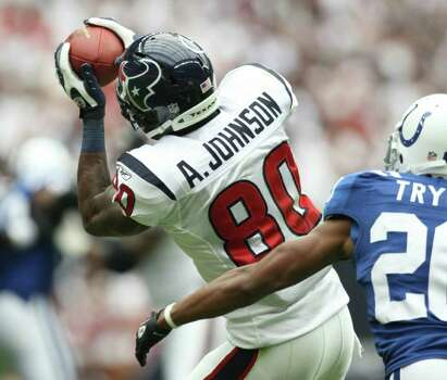Houston Texans wide receiver Andre Johnson (80) makes a catch past Indianapolis Colts defensive back Justin Tryon (20) during the first quarter of a NFL game, Sunday, Sept. 11, 2011, at Reliant Stadium in Houston. Photo: Nick De La Torre, Houston Chronicle / © 2011 Houston Chronicle