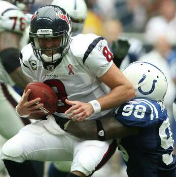 Houston Texans quarterback Matt Schaub (8) is tackled by Indianapolis Colts defensive end Robert Mathis (98) during the second quarter of a NFL game, Sunday, Sept. 11, 2011, at Reliant Stadium in Houston. Photo: Nick De La Torre, Houston Chronicle / © 2011 Houston Chronicle