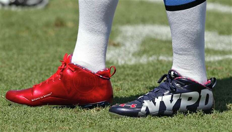 Detroit Lions quarterback Shaun Hill wears cleats in honor of the 9/11 New York Fire and Police Departments before an NFL football game against the Tampa Bay Buccaneers Sunday, Sept. 11, 2011, in Tampa, Fla. (AP Photo/Chris O'Meara) Photo: Associated Press