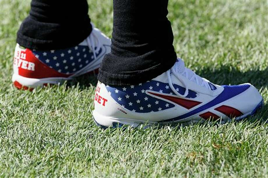Atlanta Falcons wide receiver Roddy White wears commemorative cleats  on the 10th anniversary of the Sept. 11 attacks before an NFL football game against the Chicago Bears in Chicago, Sunday, Sept. 11, 2011. (AP Photo/Charles Rex Arbogast) Photo: Associated Press