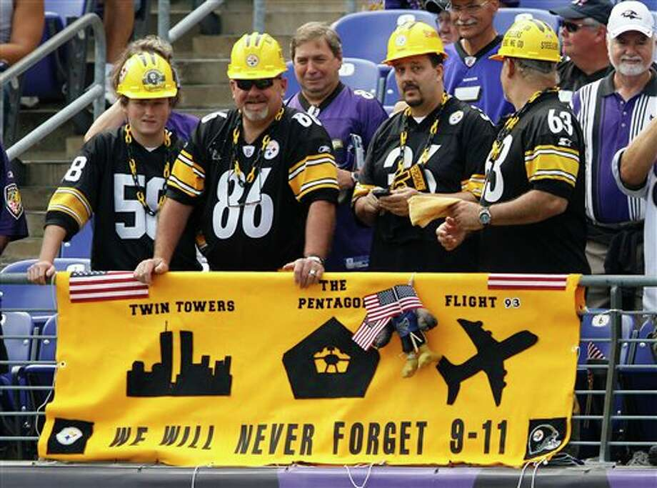 Pittsburgh Steelers fans stand behind a banner honoring the ten year anniversary of the Sept. 11, 2001, terrorist attacks before an NFL football game between the Baltimore Ravens and the Pittsburgh Steelers in Baltimore, Sunday, Sept. 11, 2011. (AP Photo/Patrick Semansky) Photo: Associated Press